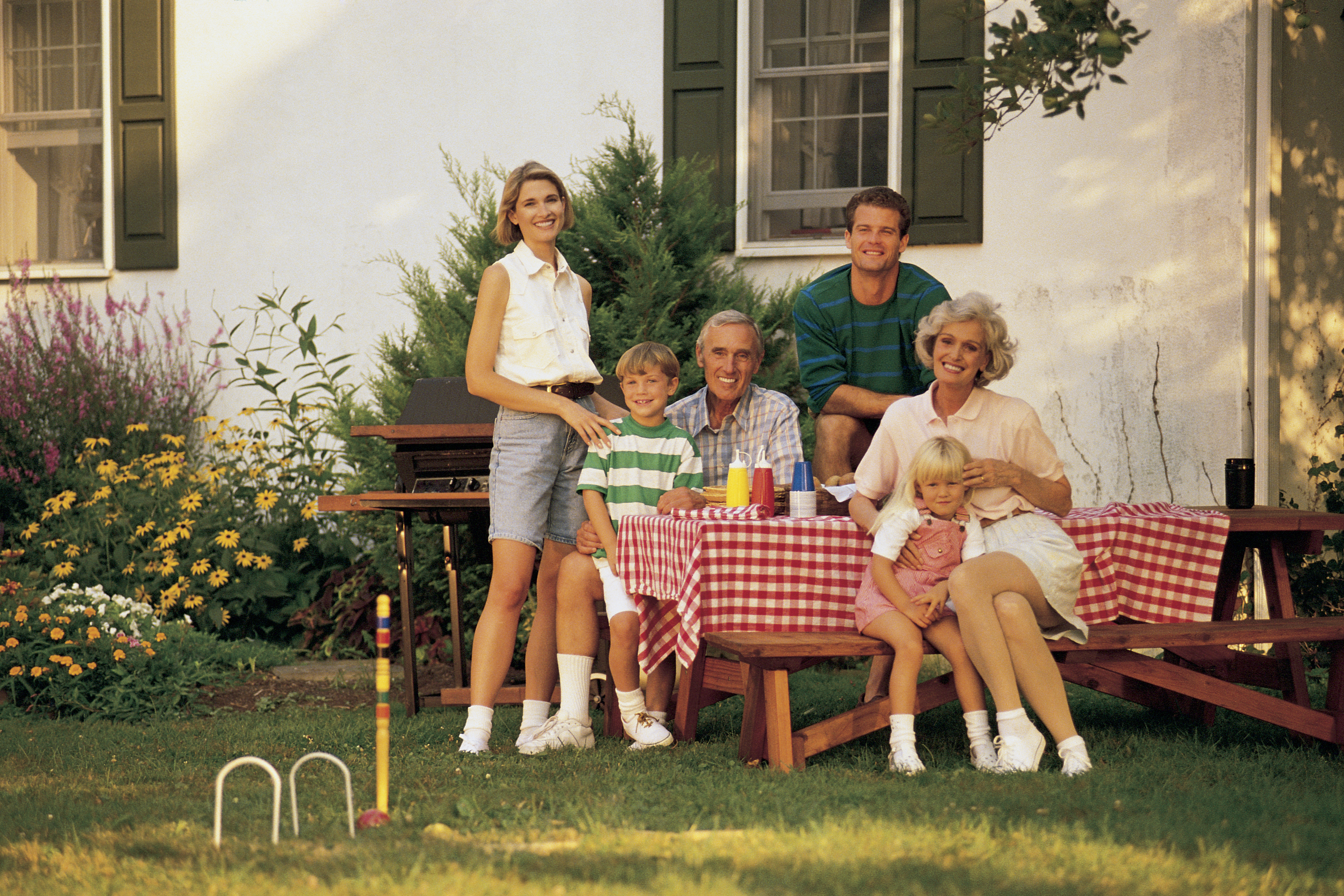 Portrait of family at picnic table