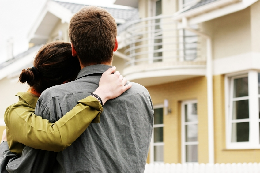 Picture of a couple looking at a home