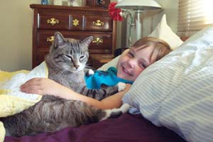 Pic of a young boy with his cat